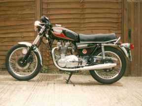 A very late T140 and possibly the worst bike I ever owned, notice the Ali barrel and the rear sets